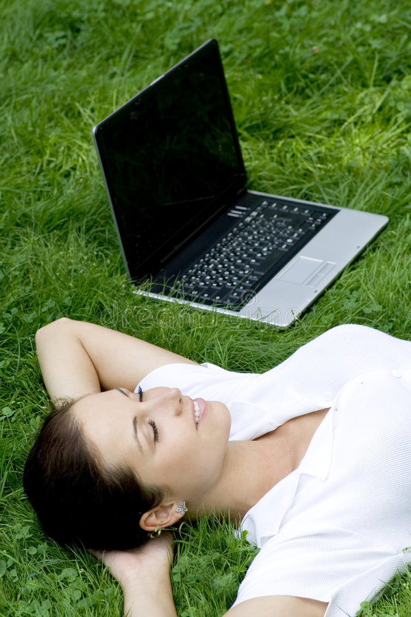 Woman Lying On Grass With Laptop Stock Photos