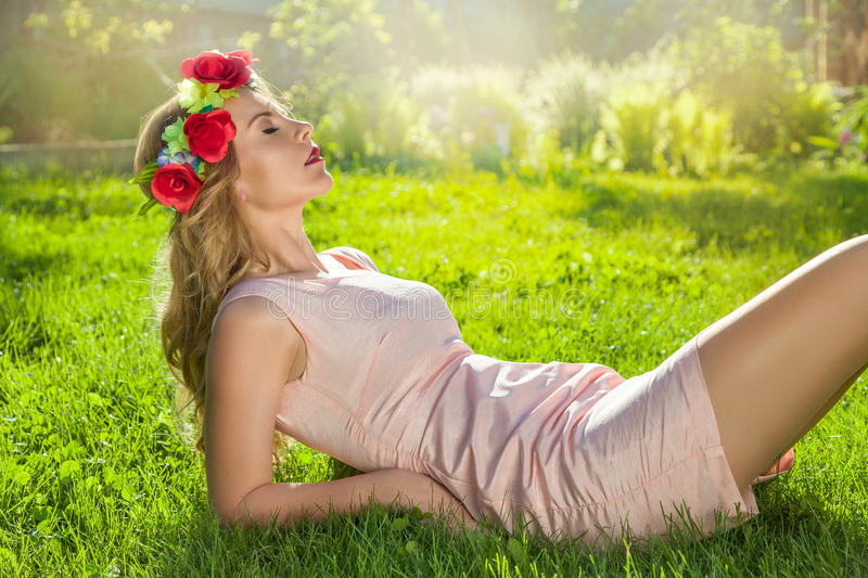 Woman lying on grass royalty free stock image