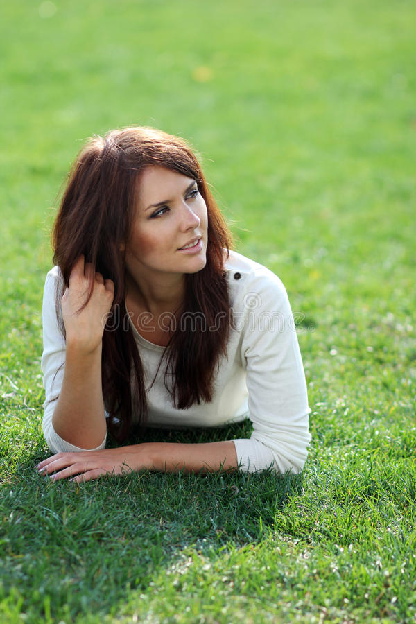 Download Woman Lying On A Green Lawn Stock Image - Image: 21519419