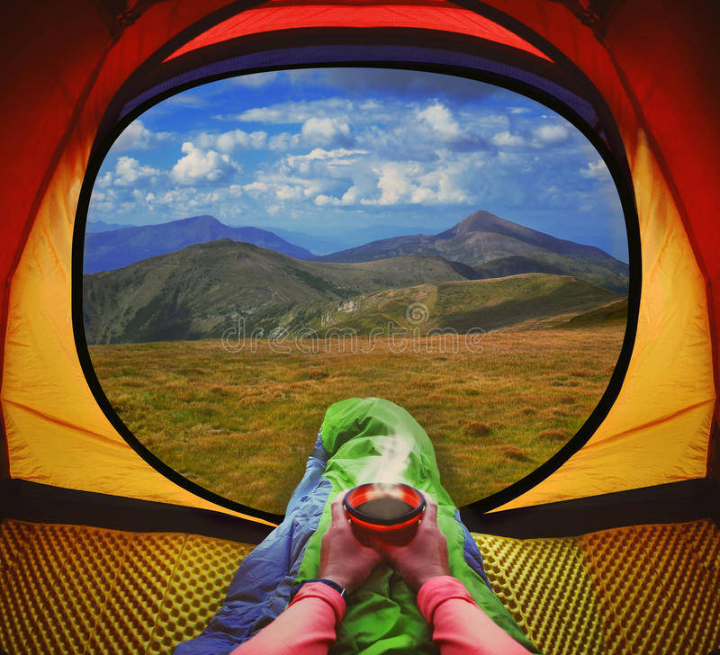 Free Woman Lying In A Tent With Coffee ,view Of Mountains And Sky Stock Photos - 57441343