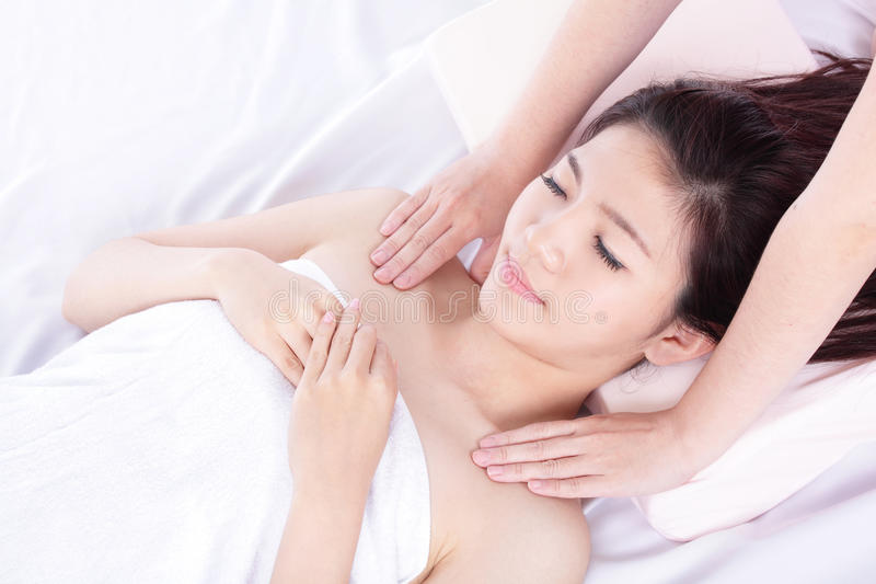 Woman lying on massage table in a health spa royalty free stock photos
