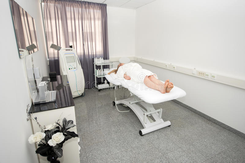 Woman lying on massage table prepaired for beauty treatment. royalty free stock photography