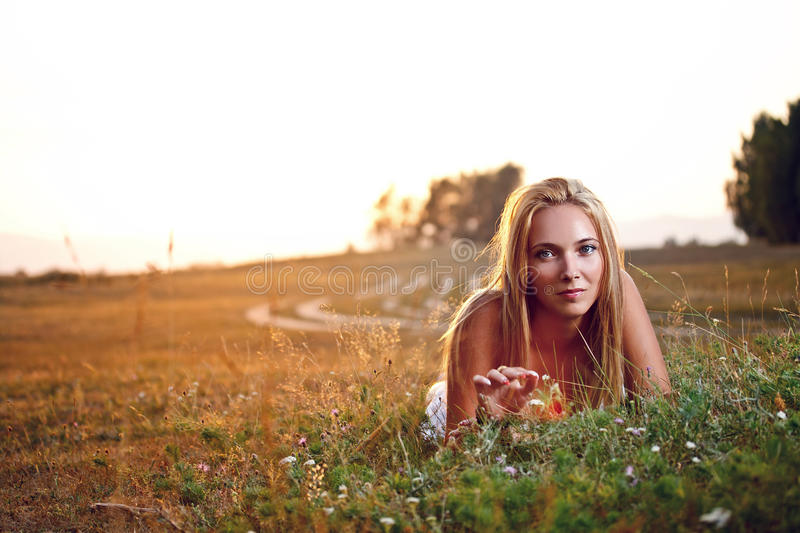 Woman lying in meadow stock images