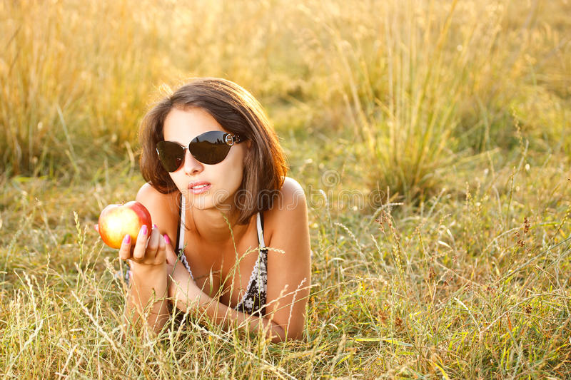 Woman lying at meadow stock images