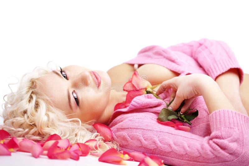 Woman lying on petals royalty free stock photos