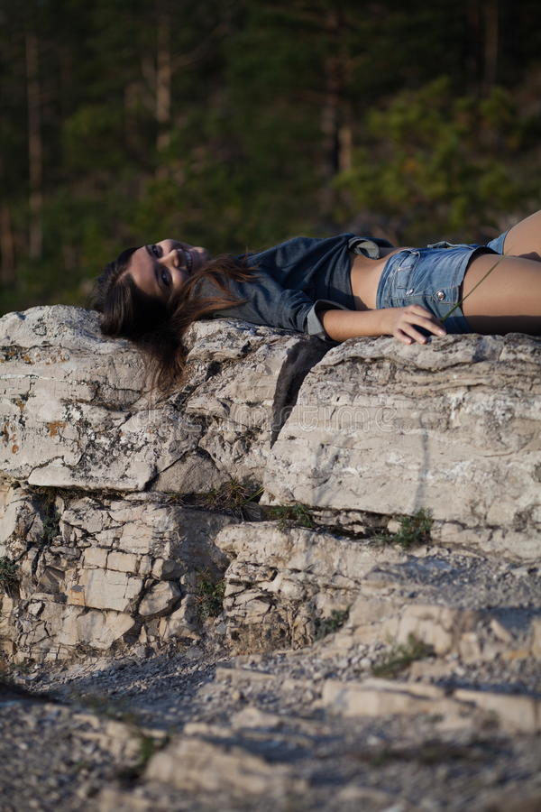 Download Woman lying upon rocks stock photo. Image of forest, down - 23836928