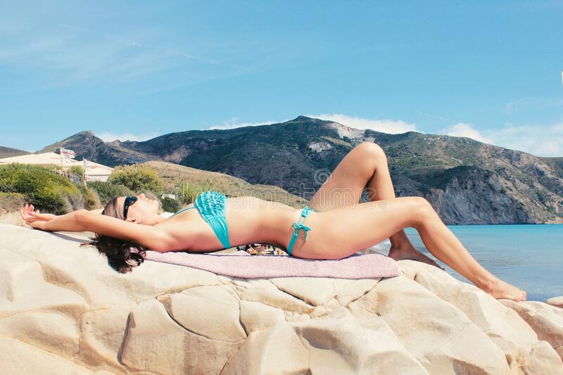 Woman Lying On Rocks At The Beach Free Public Domain Cc0 Image