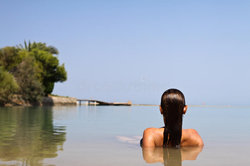 Woman lying in the water royalty free stock photography