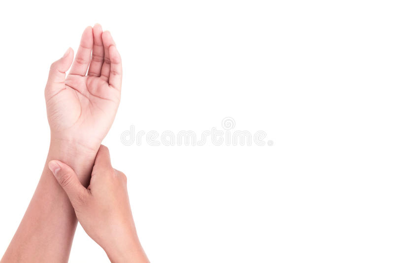 Woman& x27; mão de s que verifica o pulso no pulso, nos cuidados médicos e no co médico imagem de stock