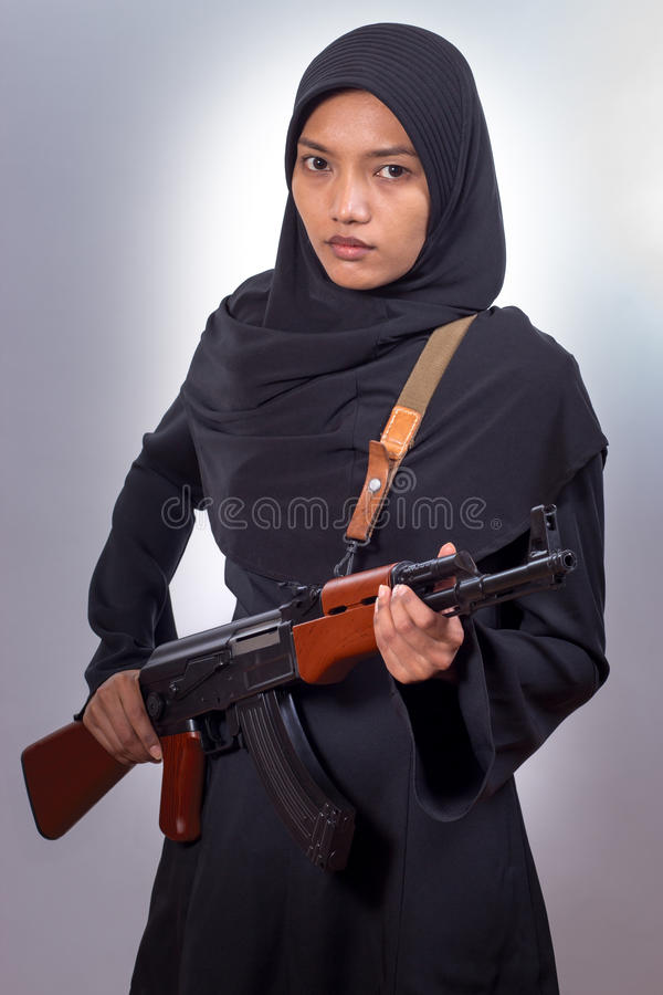 Woman with a machine gun stock images