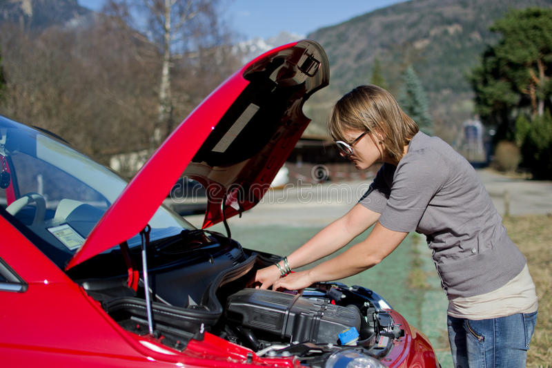 Woman with machine trouble stock images