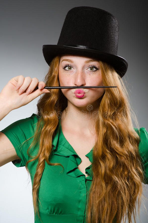 Woman magician wearing stock image