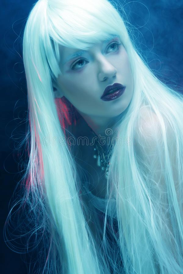 Woman with magnificent white hair. Young woman with magnificent white hair stock image