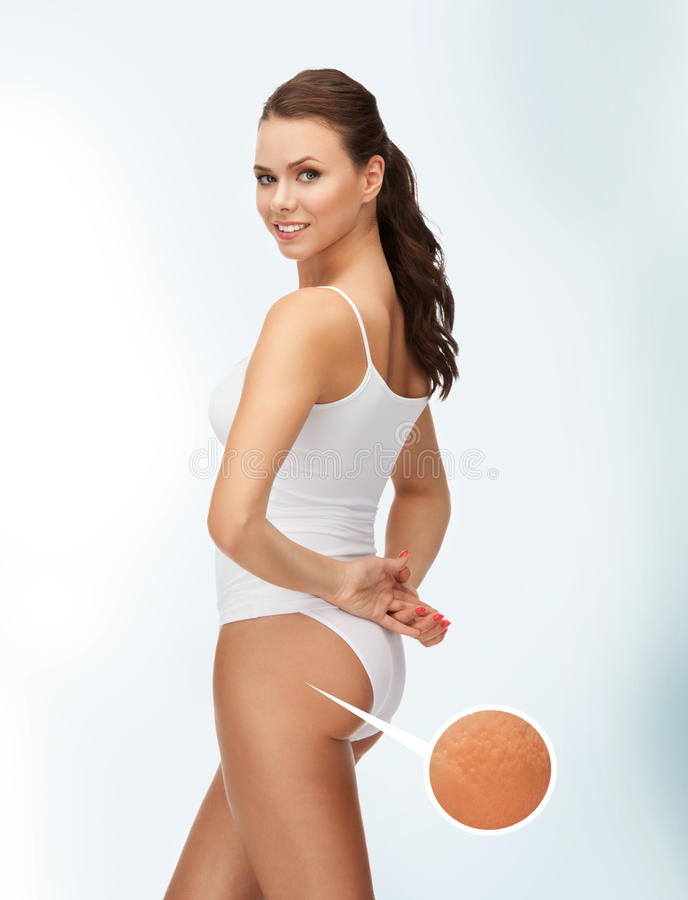 Woman with magnifier showing cellulite stock photography