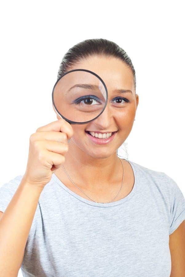 Woman magnifying eye royalty free stock image