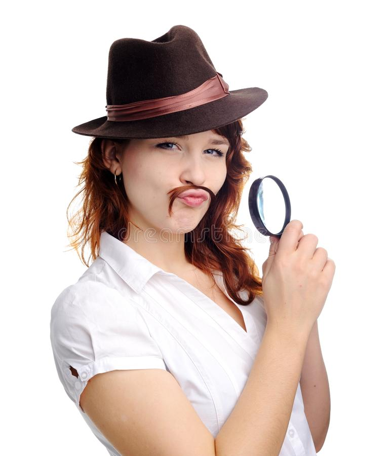 Woman with magnifying glass. An image of a woman with magnifying glass royalty free stock images