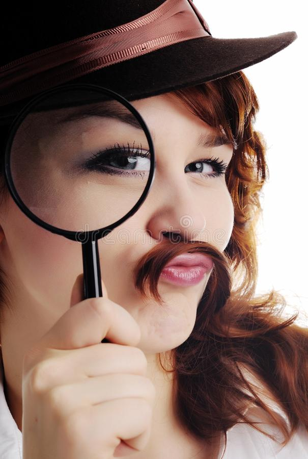 Woman with magnifying glass stock images