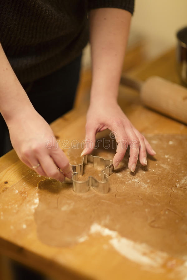 Woman Baking Gingerbread for Christmas stock images
