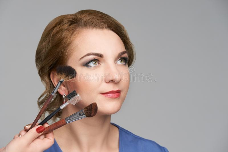 Woman make makeup. Face cosmetic. Skin care. Facial hightlighter. Mascara royalty free stock photography