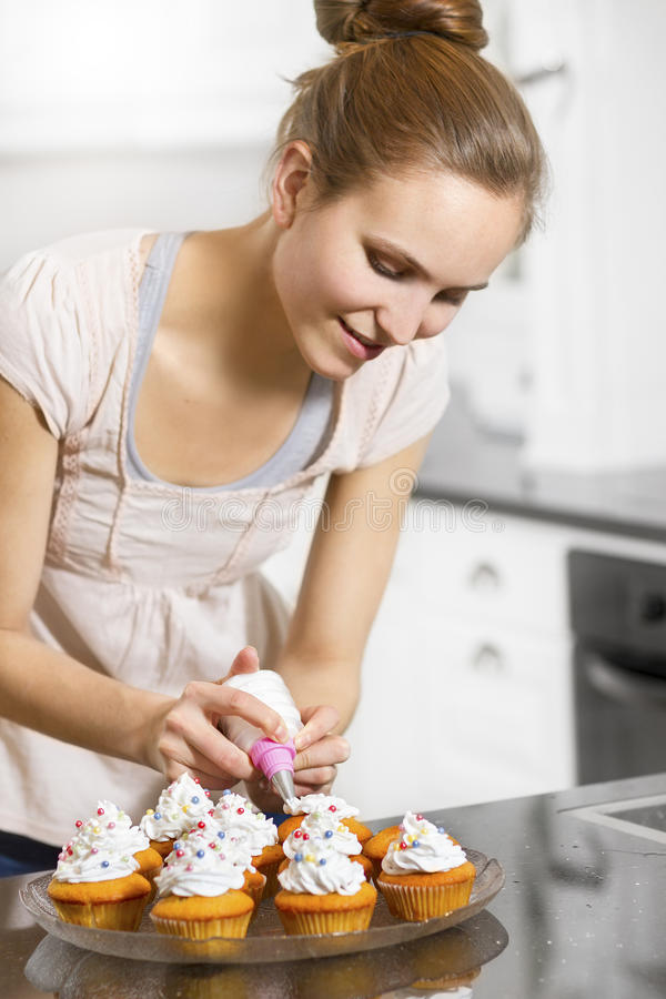 Woman make Muffins stock image