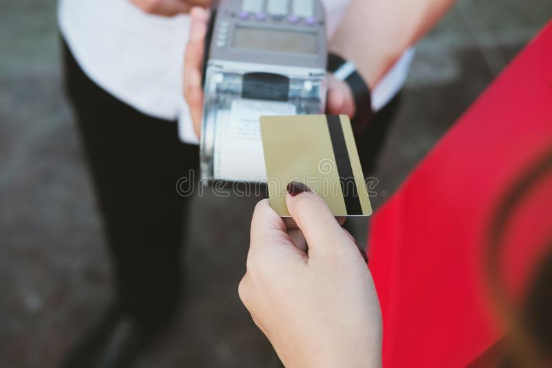 Woman make payment with credit card swipe through terminal. customer paying with EDC or swiping machine. buy & sell product or se. Woman make payment with credit stock photos