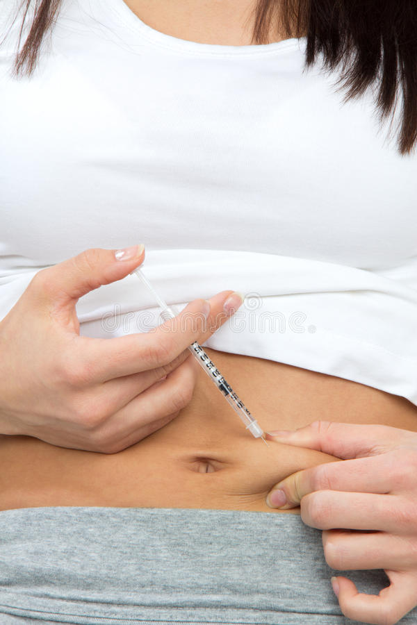 Woman make subcutaneous insulin injection. Diabetes patient make a subcutaneous insulin injection by single use syringe with needle and Rapid-acting humalog stock photography