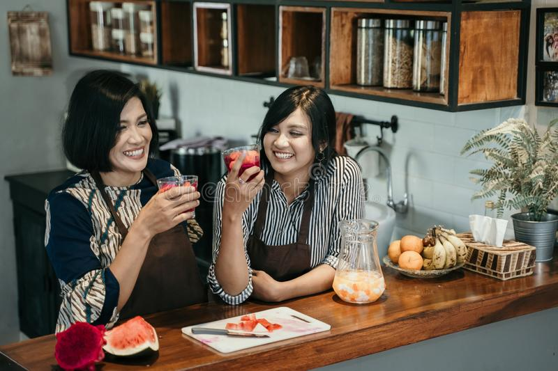 Woman make sweet drink from fruits stock photography