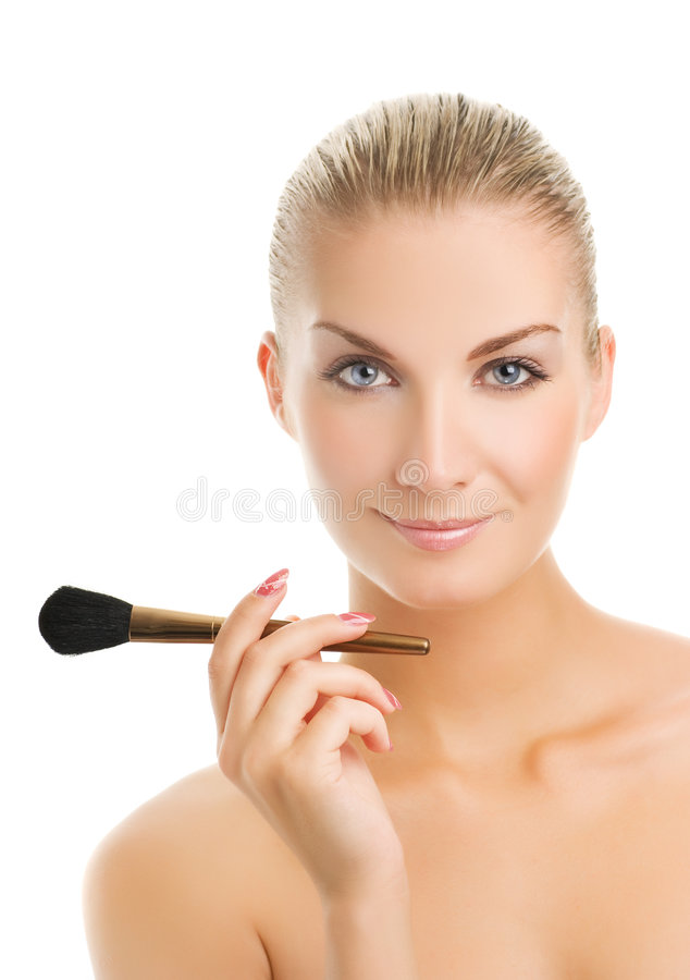 Woman with a make-up brush. Lovely young woman with a make-up brush. Isolated on white background stock photos