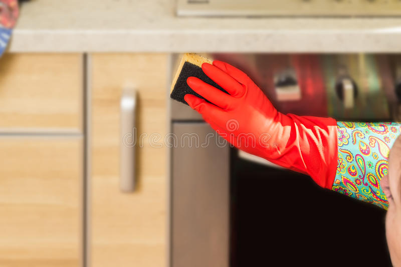 Woman makes chores in the kitchen at home. stock images