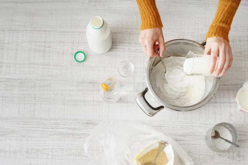 Download Woman Makes The Dough In The Pan Stock Photo - Image: 83712136