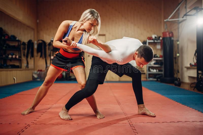 Woman makes elbow kick, self-defense workout royalty free stock images
