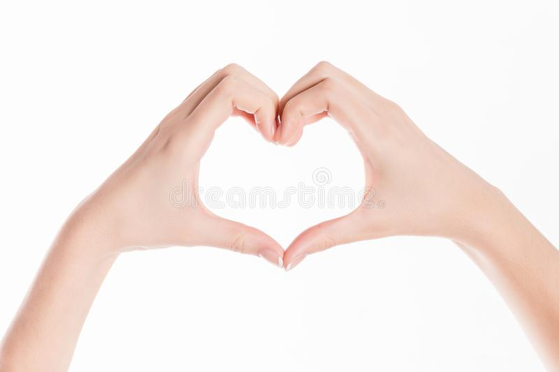 Isolated background showing woman hands making a heart for saint valentines day royalty free stock photo