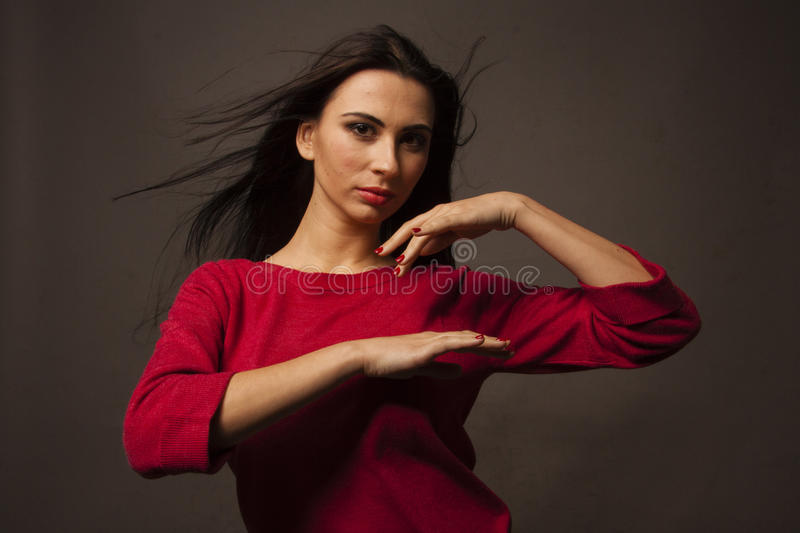 Woman makes indian dance stock photo