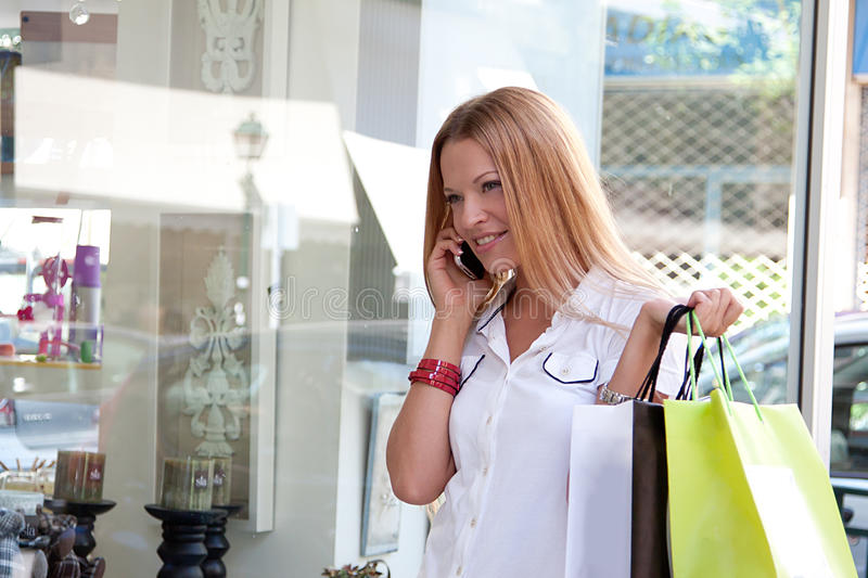 Download A woman makes a purchase stock image. Image of retail - 25712545