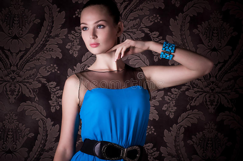 Download Woman With Makeup In Blue Dress Royalty Free Stock Photos - Image: 27935878