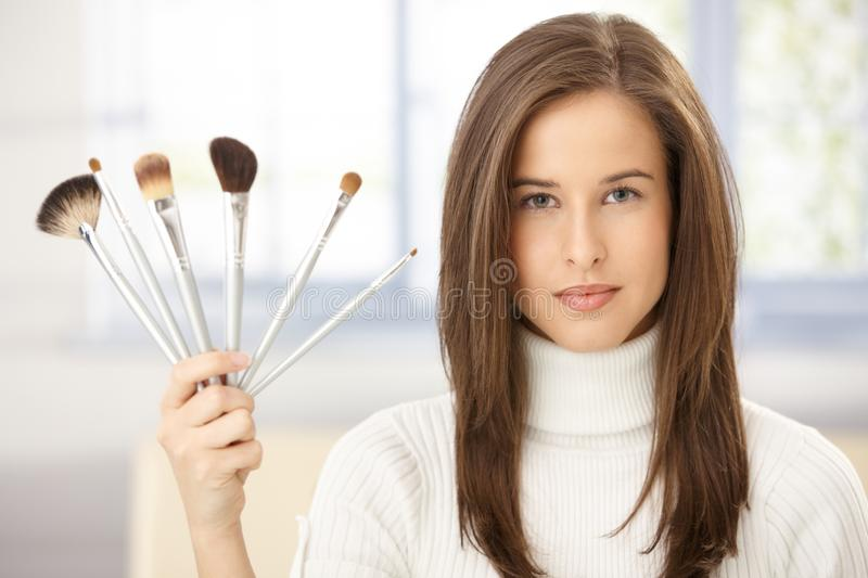 Woman with makeup brush collection royalty free stock photography