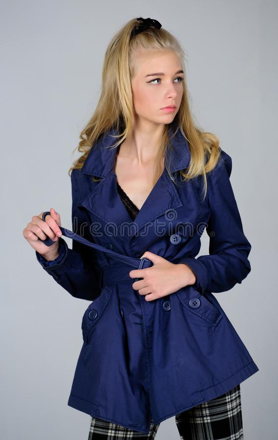 Woman makeup face blonde hair posing coat with collar. Clothes and accessory. Girl fashion model wear coat for spring. And autumn season. Trench coat fashion royalty free stock photos