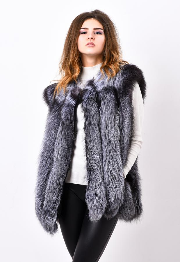 Woman makeup face wear fur vest white background. Silver fur vest fashion clothing. Luxury fur accessory clothes. Fashion trend concept. Winter fashionable royalty free stock images