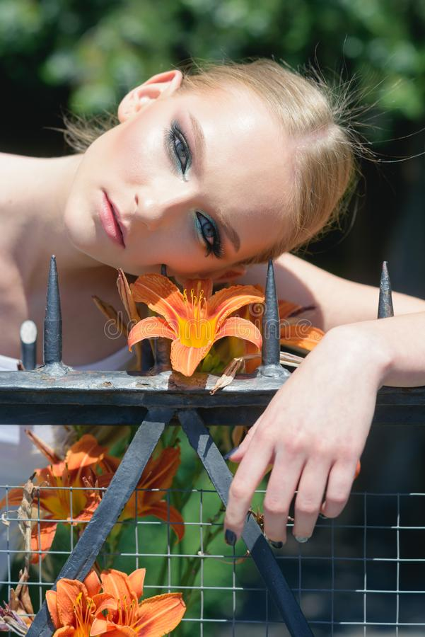 Woman with makeup on healthy skin with flower stock images