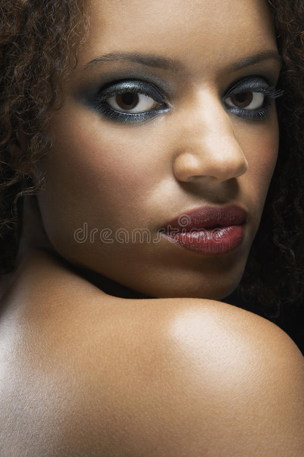 Woman With Makeup Looking Over Shoulder stock photo