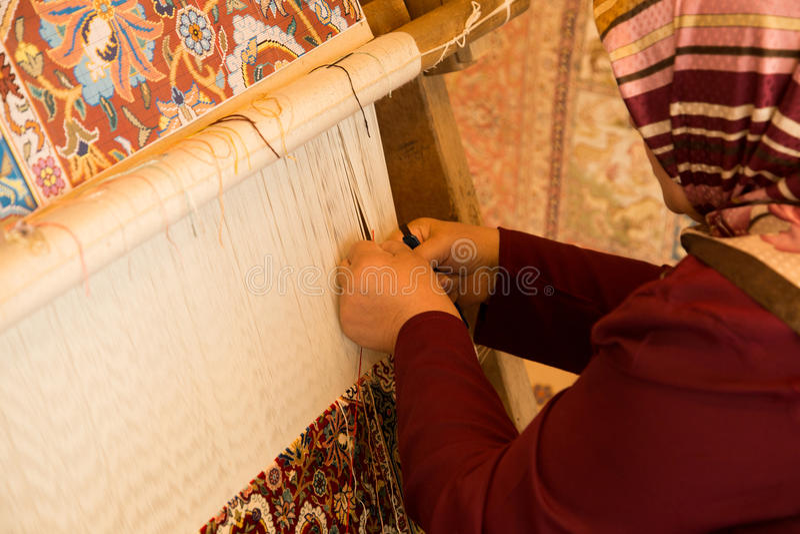 Download Woman Making Carpet editorial photo. Image of yellow - 34530411