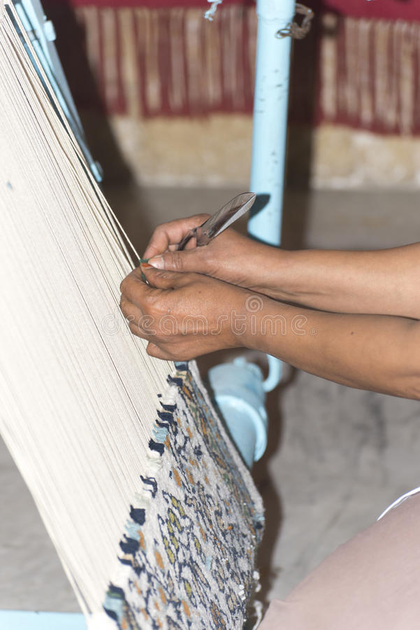 Woman making carpet royalty free stock photography
