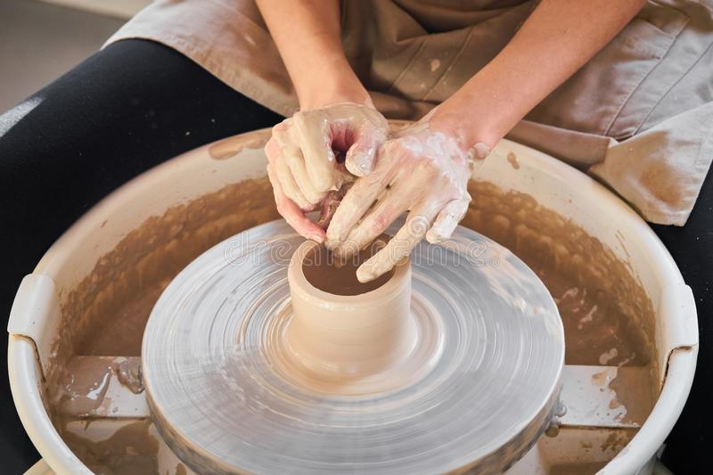 Woman making ceramic pottery on wheel, creation of ceramic ware. Concept of women`s work, craft stock photos
