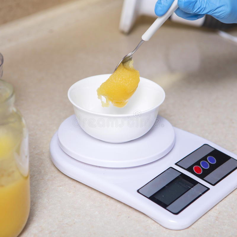 Woman making cheesecake dessert on her kitchen. No sugar, health. Y homemade food. Proper nutrition stock image
