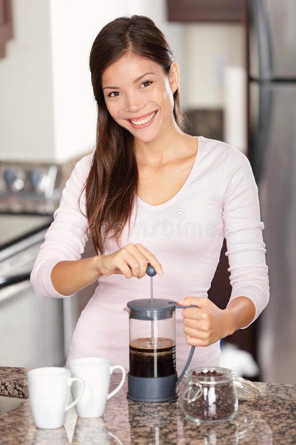 Woman making coffee in kitchen stock photo
