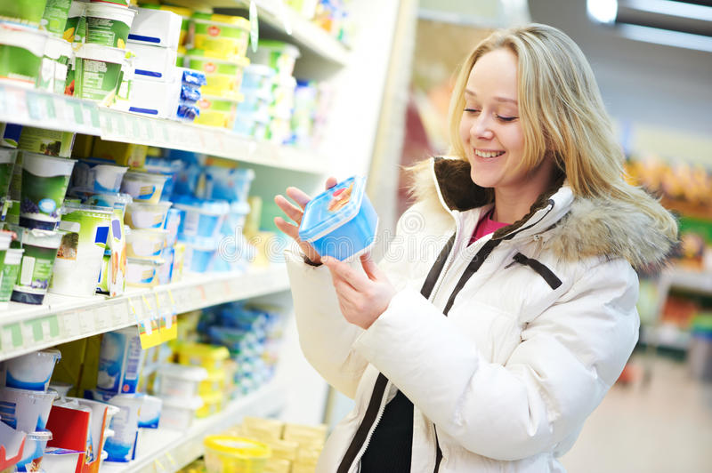 Woman making dairy shopping royalty free stock images