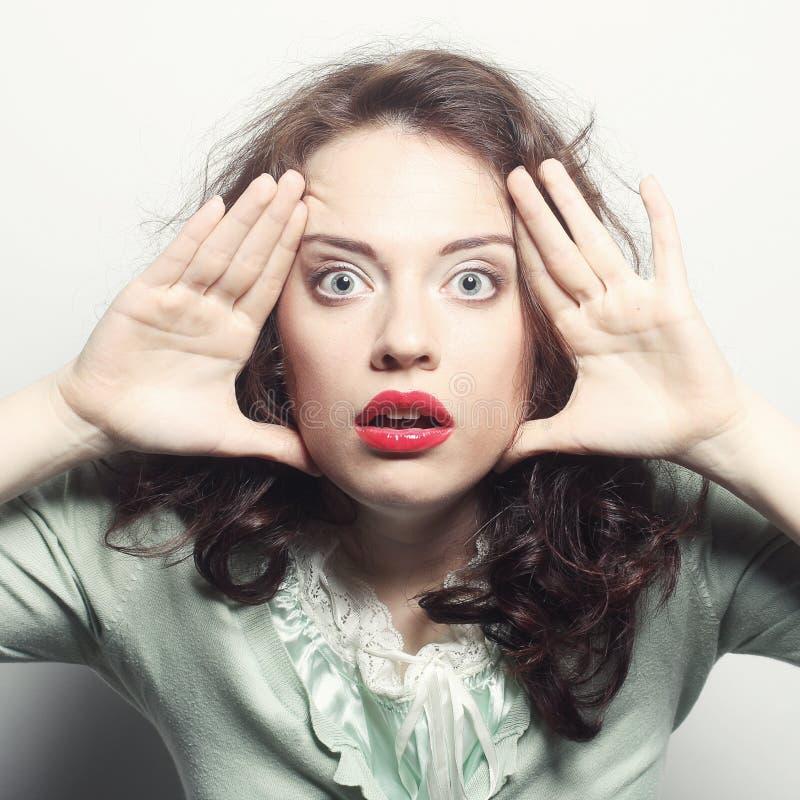 Woman making a funny face. Studio shot stock photo