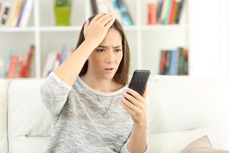 Woman making mistake on a smart phone royalty free stock photography