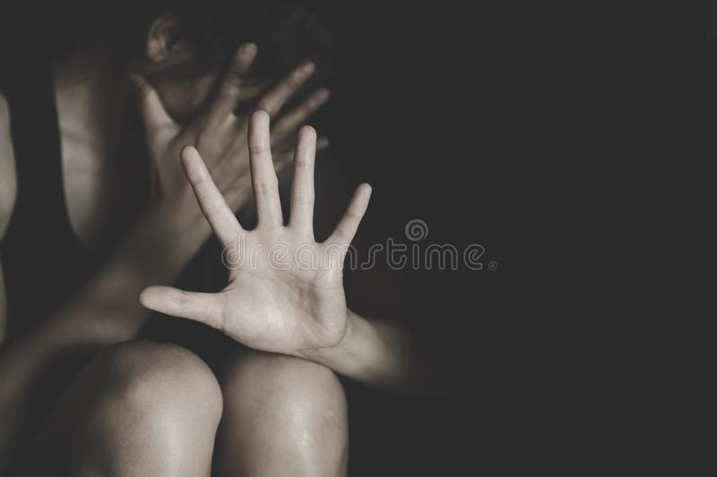 Woman making NO or STOP gesture with hand, Stop drugs, Stop violence against children, stop violence against women, human rights. Violations, human trafficking stock images
