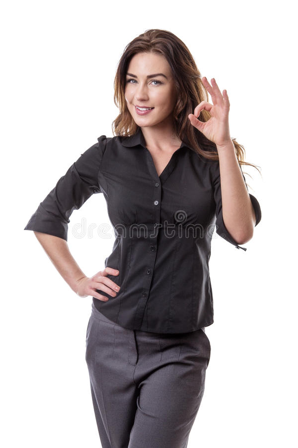 Woman making Ok sign. Pretty young woman making Ok sign with her left hand, whilst her right hand is on her hip. Isolated on white background stock photos